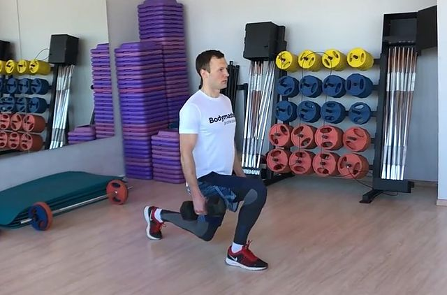 Photo of Dumbbell Rear Lunge exercise