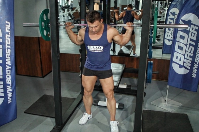 Exercise Barbell Squat To A Bench