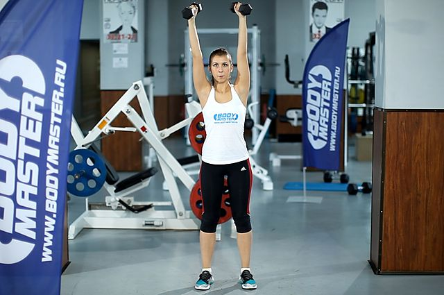 Photo of Standing Palms-In Dumbbell Press  exercise