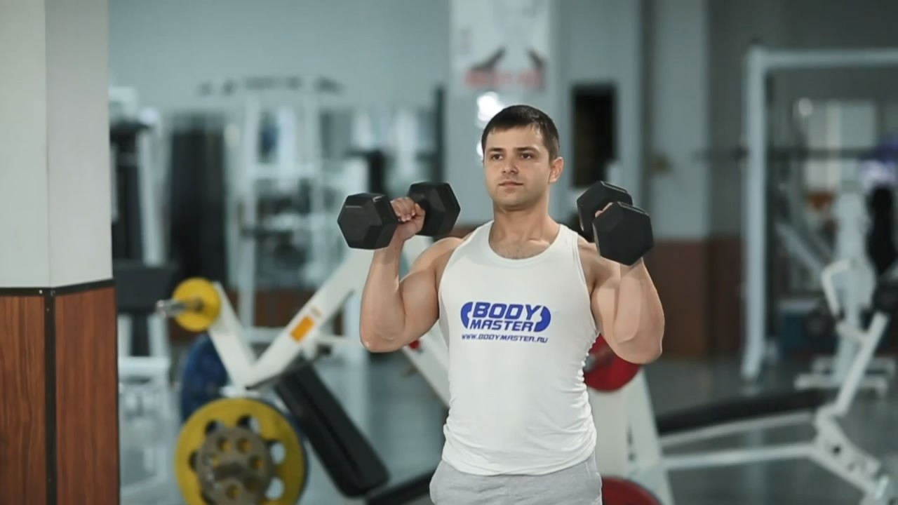 Exercise Standing Palms-In Dumbbell Press