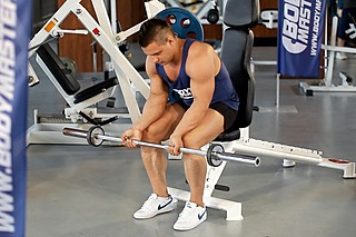 Seated Palm-Up Barbell Wrist Curl