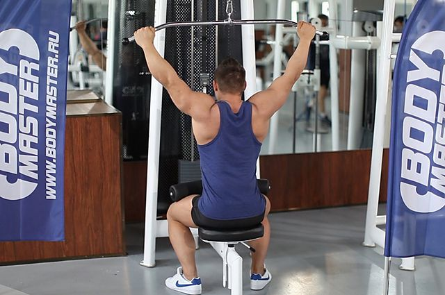 Photo of Wide-Grip Pulldown Behind The Neck  exercise